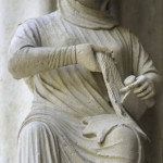 Sculpture of active woman, North Porch