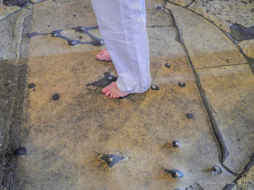 Woman's bare feet in the center of the labyrinth