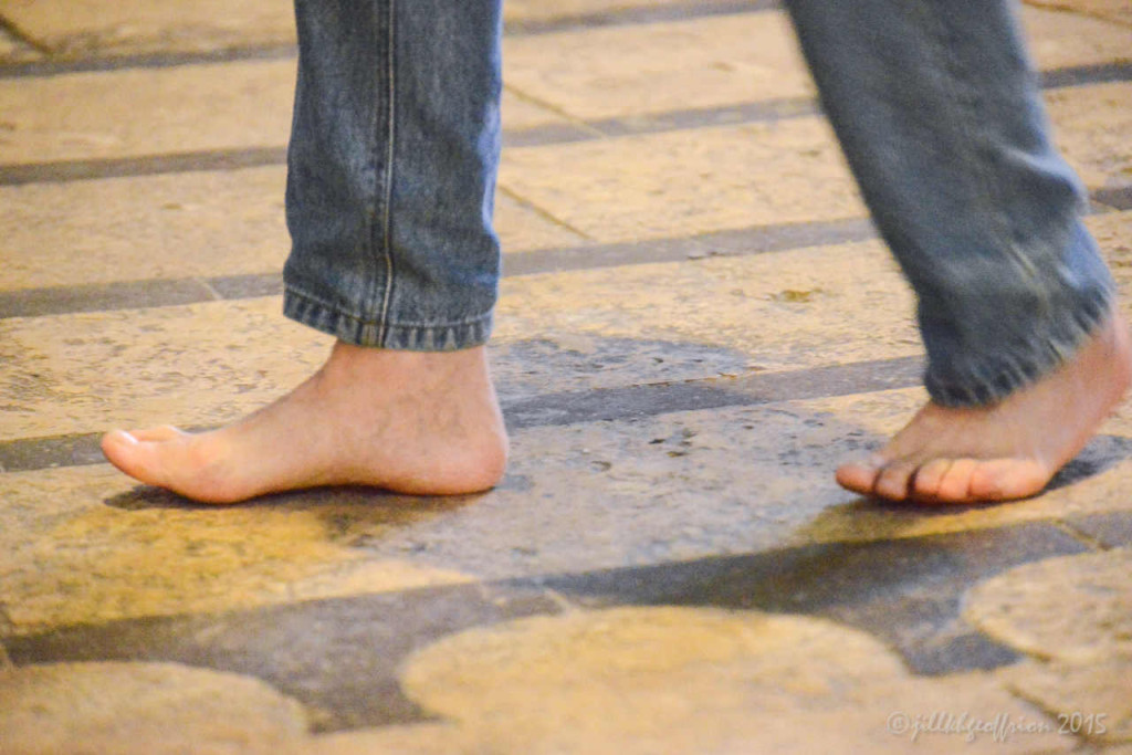 Man walking the labyrinth in bare feet