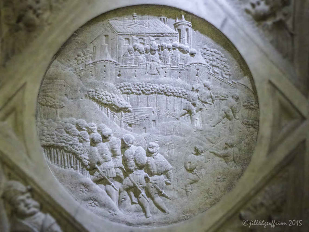 Mary's Veil being exposed over the ramparts by Bishop Guillaume in 911. Medallion of the outer south ambulatory off the choir.