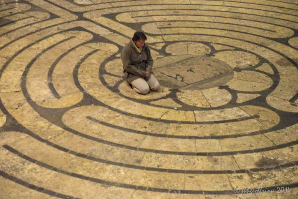 Praying in the center of the Chartres labyrinth