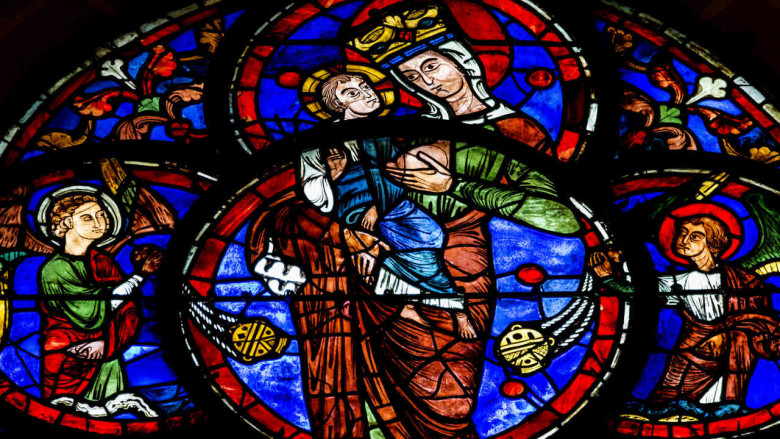 Stained glass image of Mary breastfeeding
