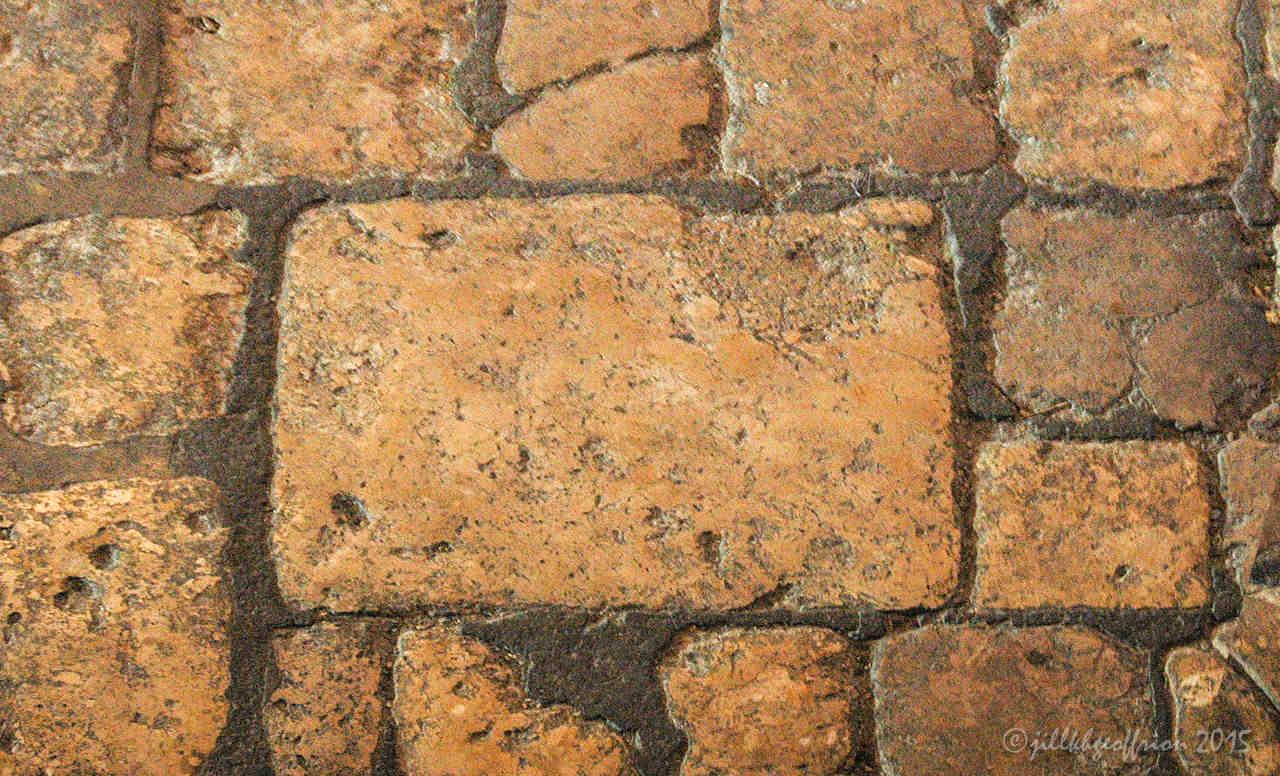 The stones of the floor inside the west central door