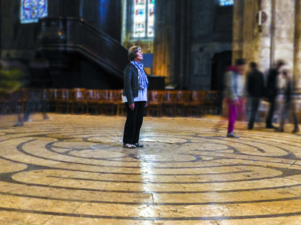 Walker praying in the center of the labyrinth