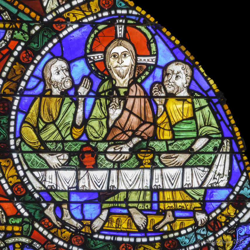 Jesus at table in Emmaus in the Passion and Resurrection Window by Jill K H Geoffrion